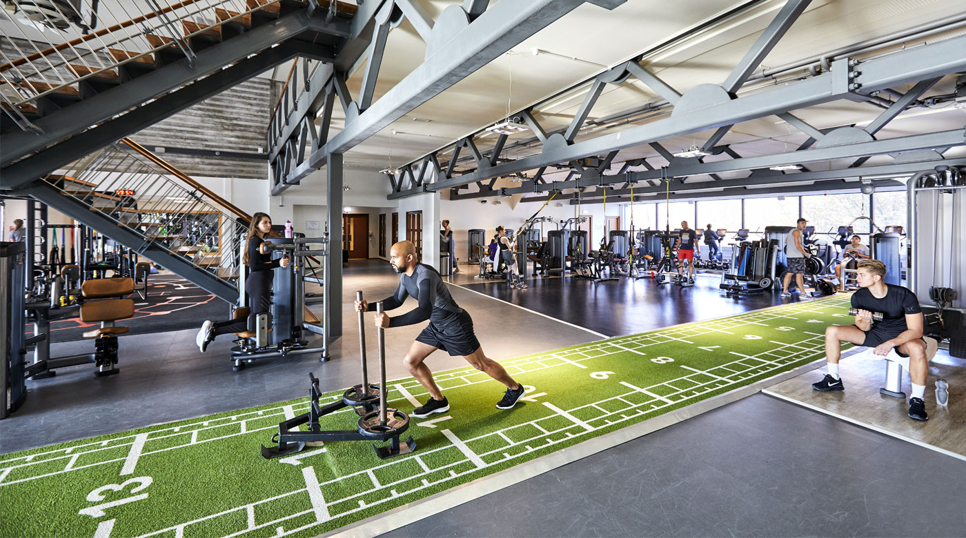 Image of man pushing weighted sled in the gym at David Lloyd Rotterdam Centrum