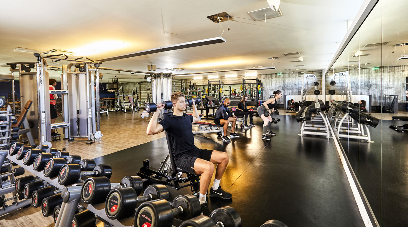 Image of man using weights in the gym at David Lloyd Rotterdam Centrum