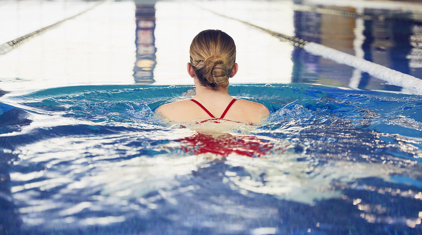 Image of lady swimming in pool at David Lloyd Clubs