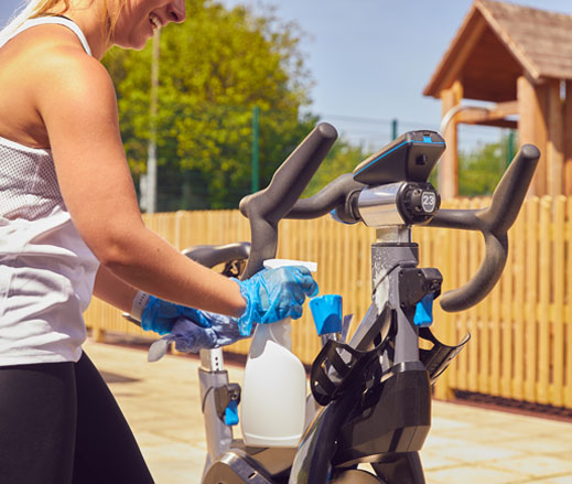 Image of lady cleaning bike