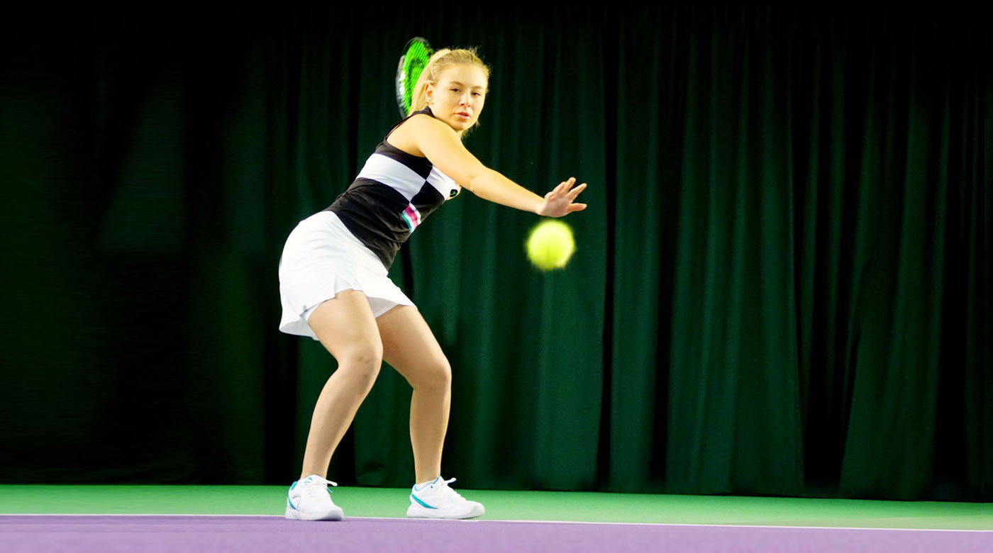 Image of lady hitting forehand at David Lloyd Clubs