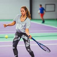 Image of girl hitting a forehand on tennis court